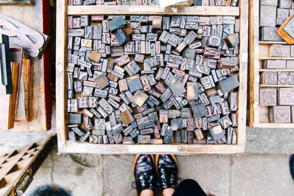 Stamping letters scattered in a box