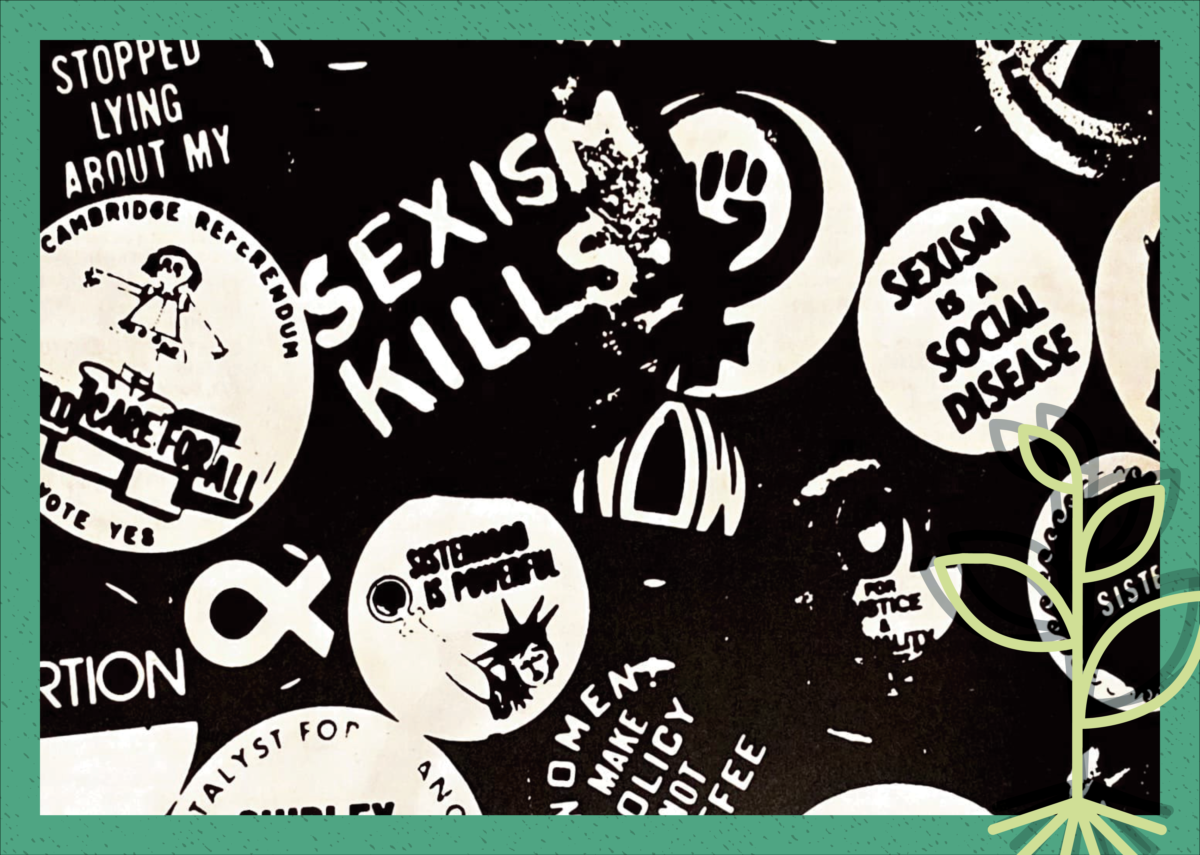 Vintage photo of a collection of feminist pins.